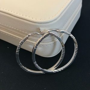 "Sterling silver 2"" loops.  Perfect condition."
